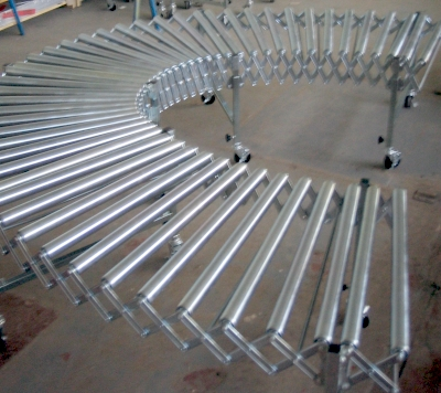 Expanding flexible conveyor with steel rollers.