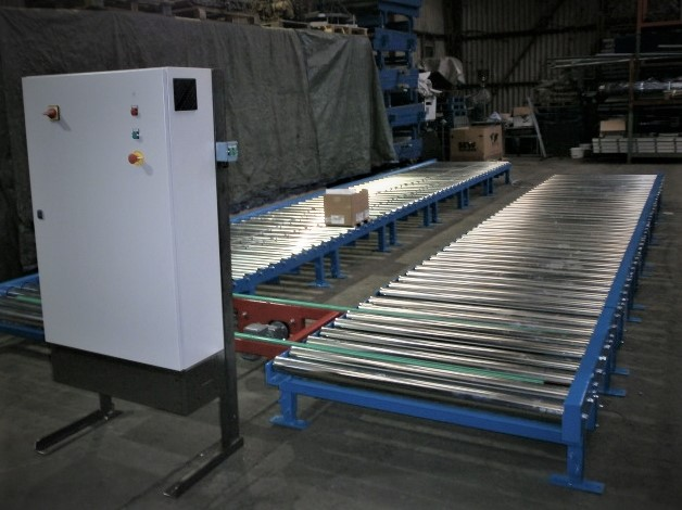 Powered roller conveyor for moving pallets.