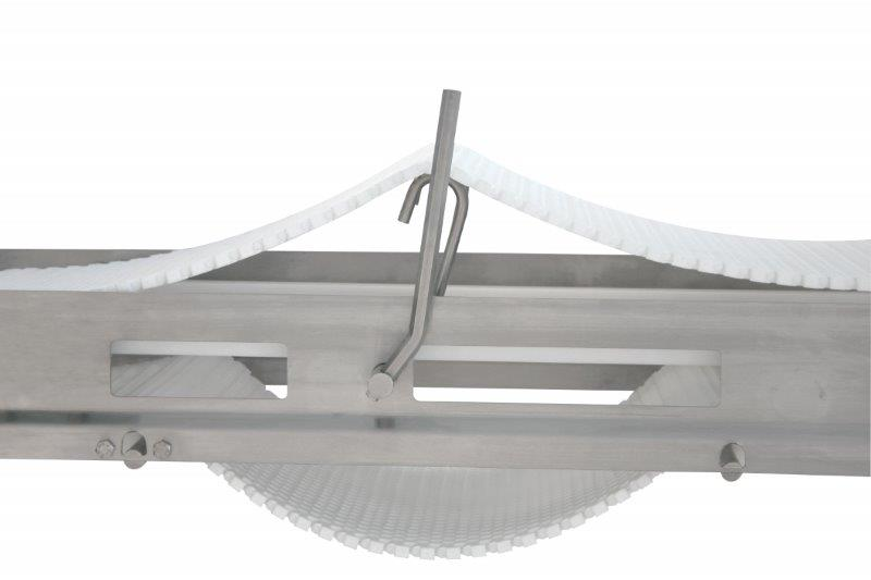 Stainless steel conveyor with lift-up modular belt.