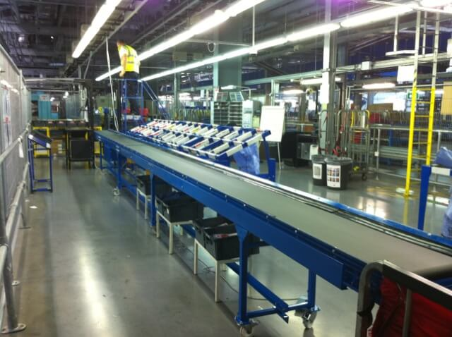 Long heavy duty belt conveyor in a factory