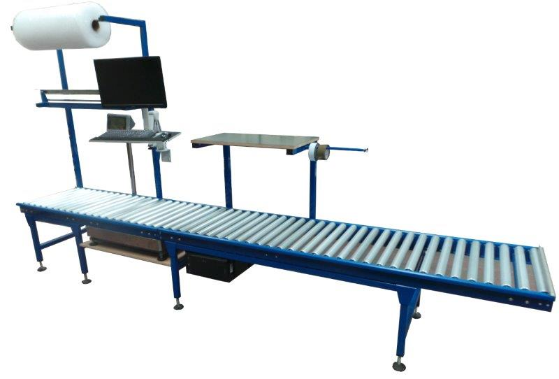 Gravity conveyor system integrated into workstation.